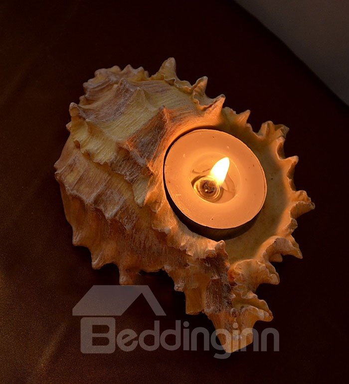 A Set of Four Shell And Starfish Shape Candle Holders